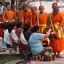 Morning Alms in Luang Prabang streets during sunrise